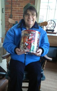 Liz and her kettle of popcorn. Beaming! In the spirit of Christmas, she'll be sharing it, too, I'm sure.